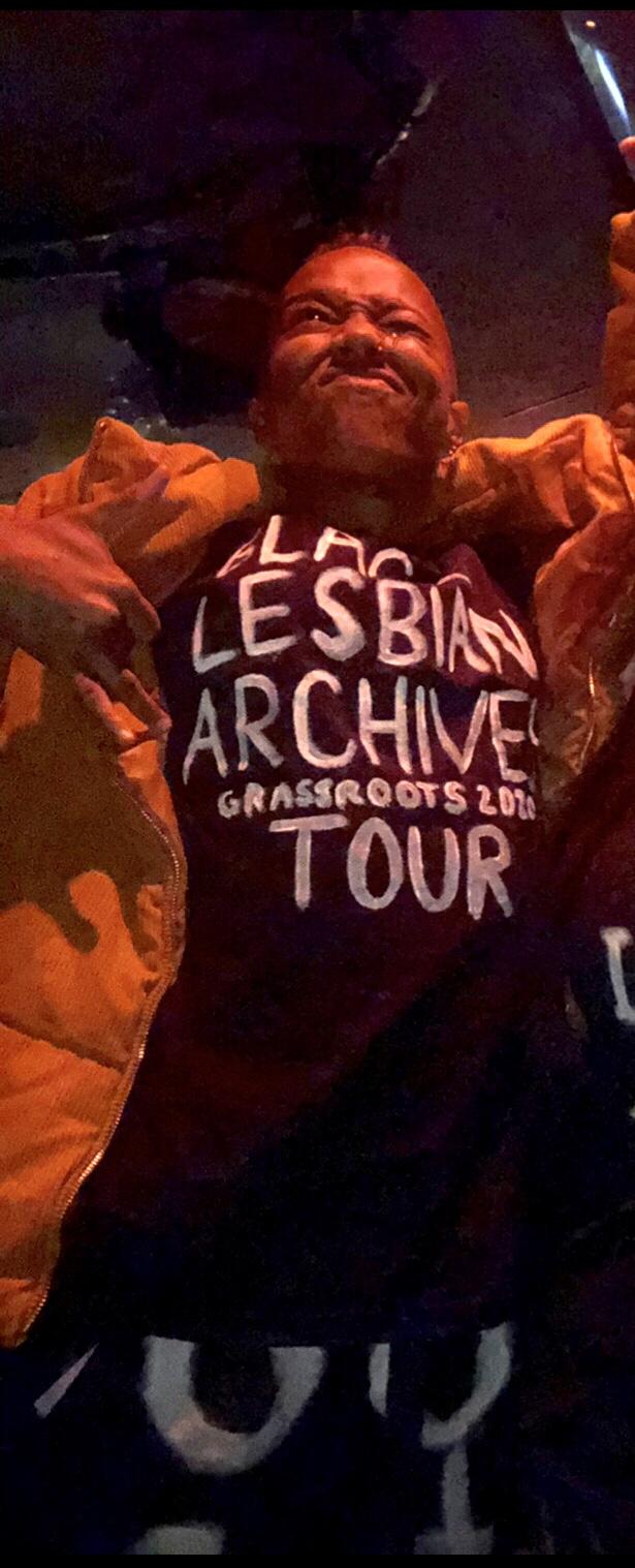 "Krü Maekdo wearing t-shirt that says ""Black Lesbian Archives Grassroots Tour 20[??]"""