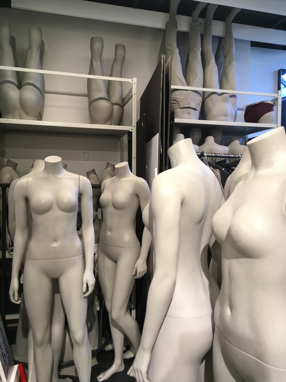 View of women's mannequins in storage.