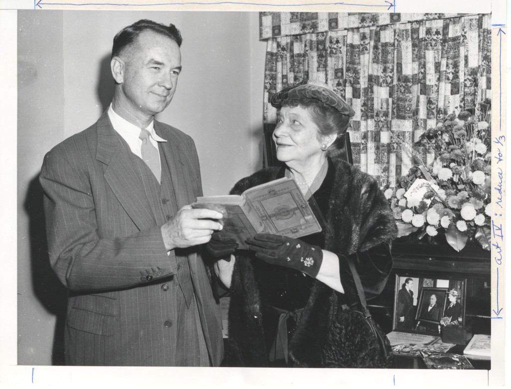 Ima Hogg (philanthropist) stands to the right of with Robert Lee Sutherland (Hogg Foundation's first director) on November 21, 1961. The two hold a record book between them as Robert looks to the left of the camera while Ima looks up at him Hogg Foundation for Mental Health.